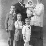 At four years old (centre) with brothers and parents.
